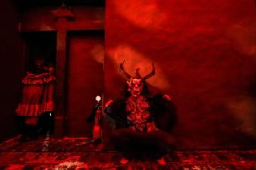 A reveller depicting the devil performs at a church in Bogota, Colombia, on 12 December 2019