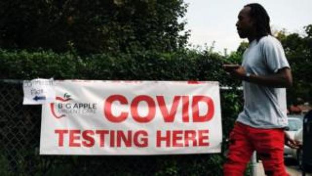 A sign directs people to a Covid-19 testing site on 14 September 2020 in the Brooklyn borough of New York City