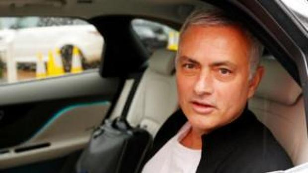 Jose Mourinho drives away after leaving his job as Manchester United manager in December