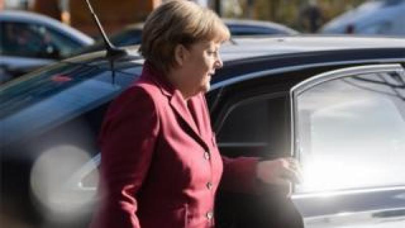Merkel arrives for talks on Friday