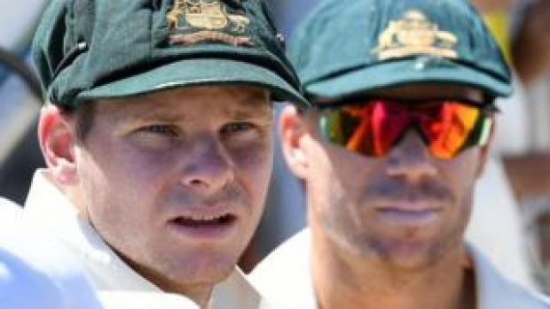 Steve Smith and David Warner wearing the baggy green caps of Australia's Test team