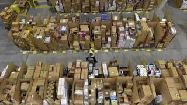 Amazon packages at a fulfilment centre