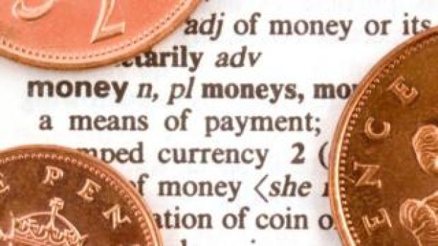 Coins on dictionary