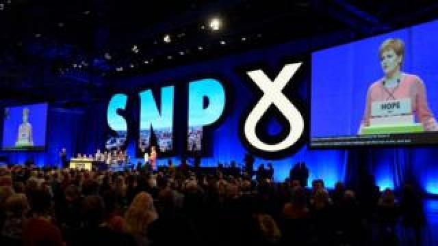 SNP conference stage wide shot from April
