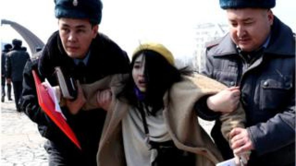 Kyrgyz police arrest a woman activist on Victory Square during the celebration of International Women's Day in Bishkek, Kyrgyzstan, 8 March 2020