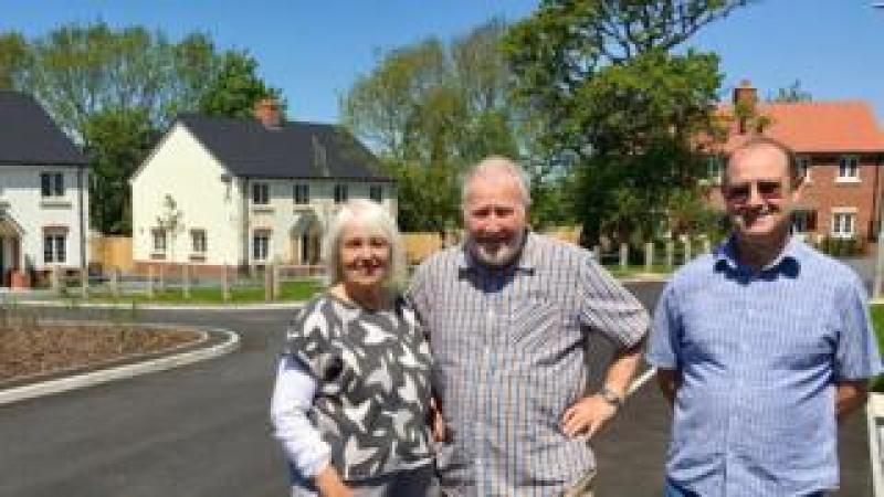 Keith Jenkin (centre) his wife Lorna and friends decided to build social housing in Lyme Regis