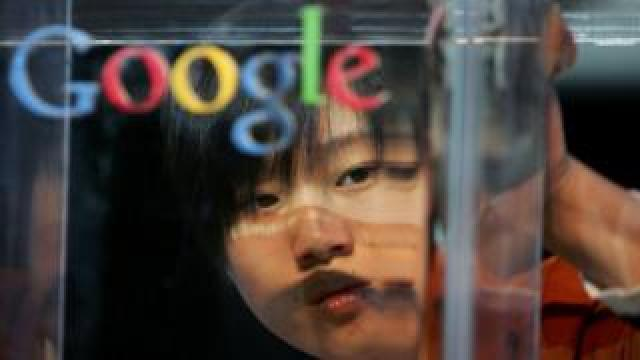 A Chinese woman's face appears behind a Google logo