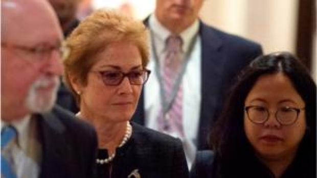 Former US Ambassador to Ukraine Marie Yovanovitch (C) arrives for a closed-doors deposition