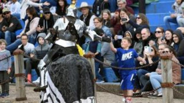 A jouster shakes hand with a spectator in Victoria, Australia