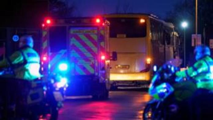 Coaches carrying the passengers arrived at Arrowe Park hospital, accompanied by police