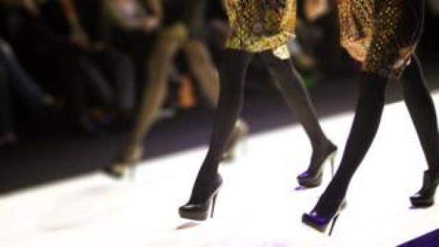 Models walking down a catwalk