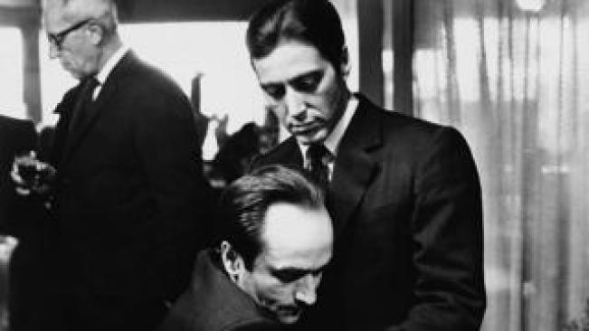 "Frederico ""Fredo"" Corleone holds his brother Michael Corleone at a family funeral in Francis Ford Coppola's The Godfather: Part II"