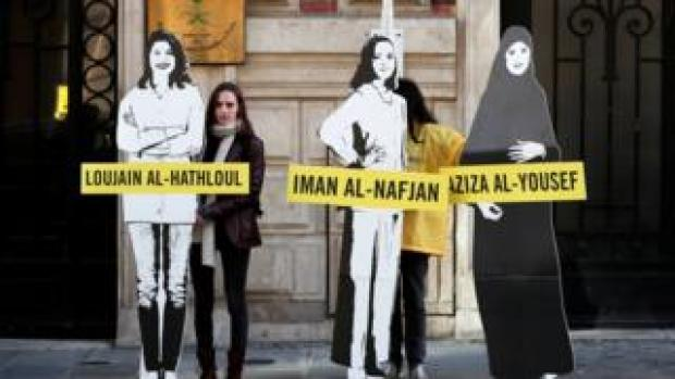 """Demonstrators from Amnesty International stage the protest on International Women""""s day"""