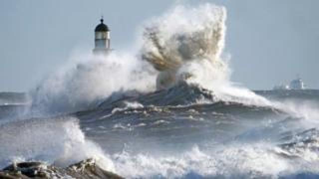 Waves crash against the pier wall at Seaham Lighthouse on the County Durham coast as weather warnings remain in owing to strong winds from Storm Atiyah.