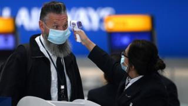 Passenger has temperature check at Heathrow airport