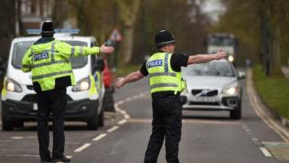 Police officers from North Yorkshire Police stop motorists in cars to check that their travel is