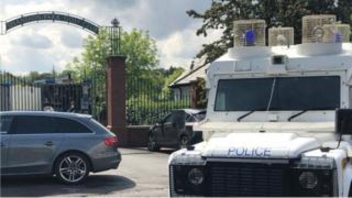 A Belfast golf club was evacuated after the discovery of a suspicious device under a car