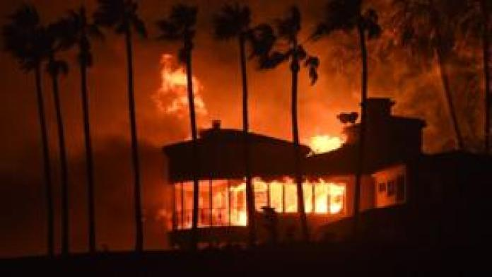 A house is burning during the Woolsey Fire on November 9, 2018 in Malibu, California