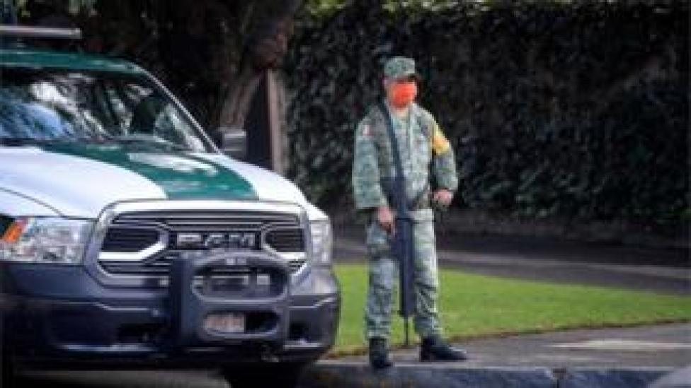 A soldier stands guard after Mexico City's Public Security Secretary Omar Garcia Harfuch was wounded in an attacked in Mexico City, on June 26, 2020