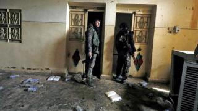 SDF fighters in an IS prison in Hajin