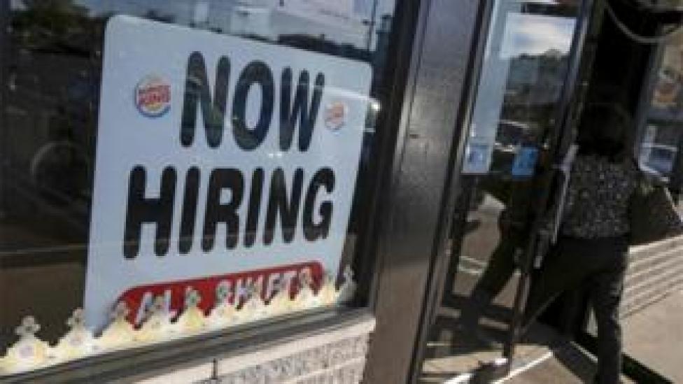 """Sign saying """"now hiring"""""""
