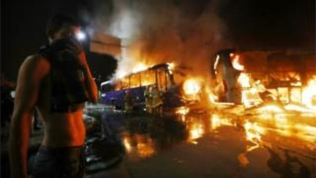 Activists set fire to buses and other vehicles in Rio de Janeiro's city centre
