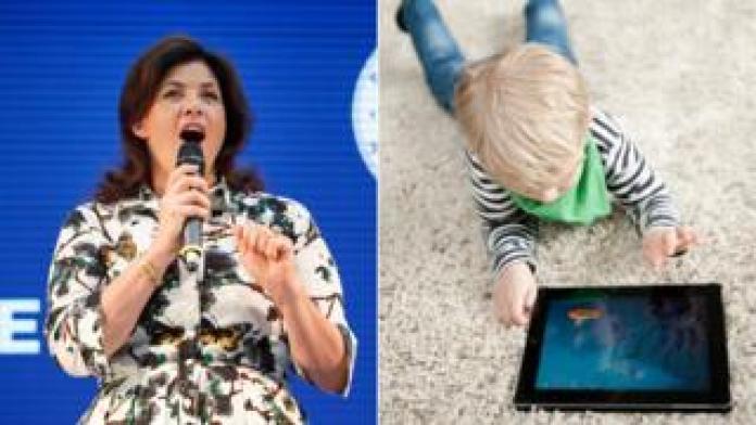 Kirstie Allsopp and child with iPad