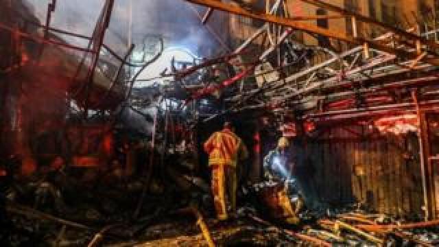 Firefighters work on the scene of the blast in Tehran, Iran. Photo: 30 June 2020