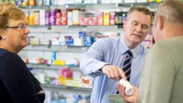Pharmacist serving customers