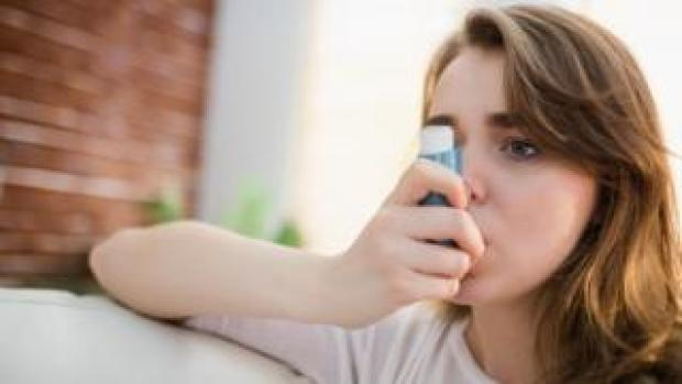 Young woman with an inhaler