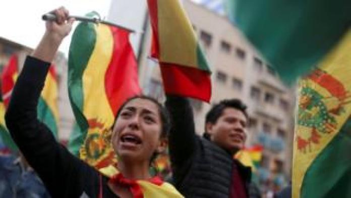 Protesters celebrate about Bolivian President Evo Morales announced his resignation