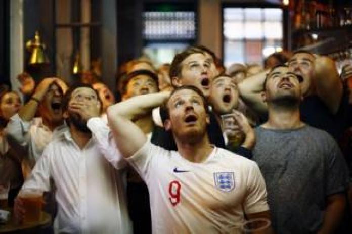 England football fans watch England play