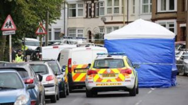 A police forensics tent at the scene in Gammons Lane