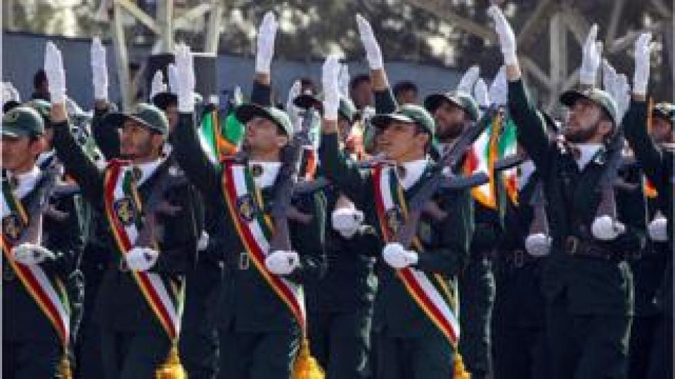 Iranian elite revolutionary guards march during an annual military parade which marks Iran's eight-year war with Iraq, in the capital Tehran on September 22, 2011.