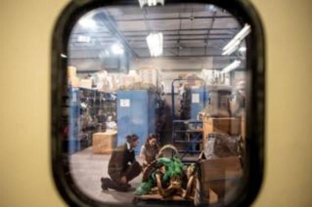 The two investigators spotted through a window examining ibex parts
