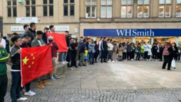 Protesters holding Chinese flags
