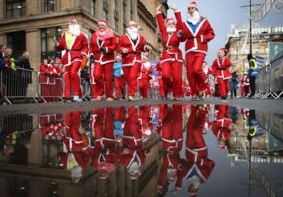 More than 7,000 members of the public taking part in Glasgow's annual Christmas Santa dash through the city centre on 8 December , 2019.