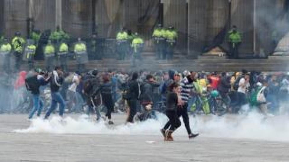 Police disperse protesters with tear gas in Plaza Bolivar in Bogotá, Colombia 22 November 2019