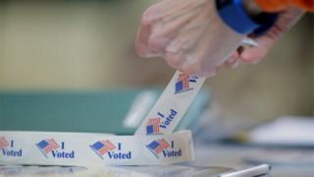Voter peels off an 'I voted' sticker