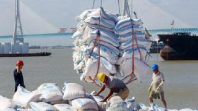 Workers unloading goods at a Chinese port