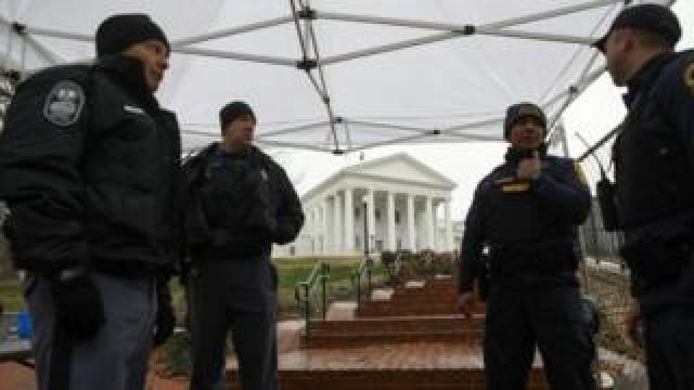 Law enforcement personnel manage a security checkpoint next to the Virginia State Capitol building in Richmond on 18 January 2020.