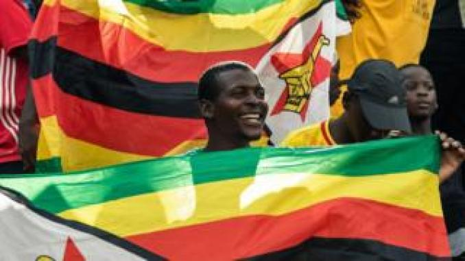 A Zimbabwe Warriors's supporter holds a flag aduring their 2019 African Cup of Nations group G qualifying football match between Zimbabwe and Congo Brazzaville at the National Sports stadium in Harare, on March 24, 2019.