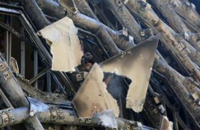 A man checks the damage after a fire erupted in a landmark building in Beirut's commercial district, Lebanon, 15 September 2020.