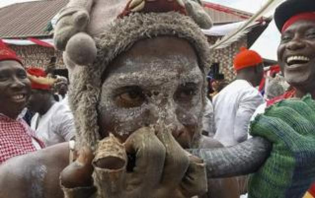 """Nigerian men attend the Idju Owhurie festival in Warri, Nigeria, 29 April 2019 (issued 30 April 2019). The biennial Owhurie cultural festival is celebrated by the people of the Agbarha Kingdom of Warri, south local government area of Delta State. It is a warlike festival popularly called """"Agbassa Juju"""" dating back to the 15th century"""
