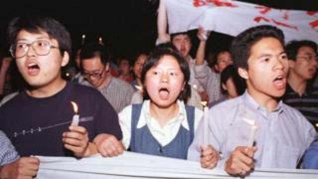 Chinese protestors march to the U.S. Embassy in Beijing May 9, 1999. Protests have erupted in a dozen or so major Chinese cities, drawing tens of thousands of angry citizens onto the streets. State media has fanned the fury by saying that the NATO bombing of the Chinese Embassy in Belgrade was a deliberate act of aggression
