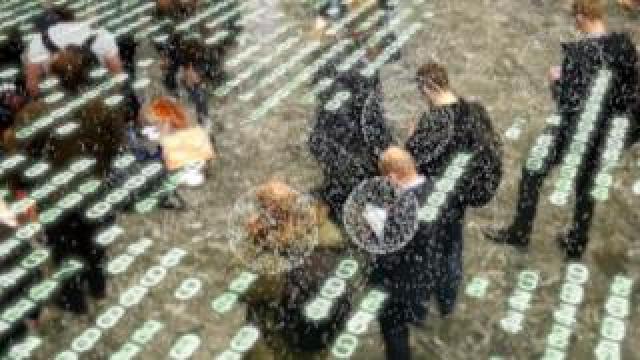 people on street with code overlaid