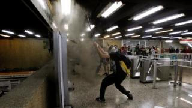 A demonstrator protests against the increase in the subway ticket prices in Santiago