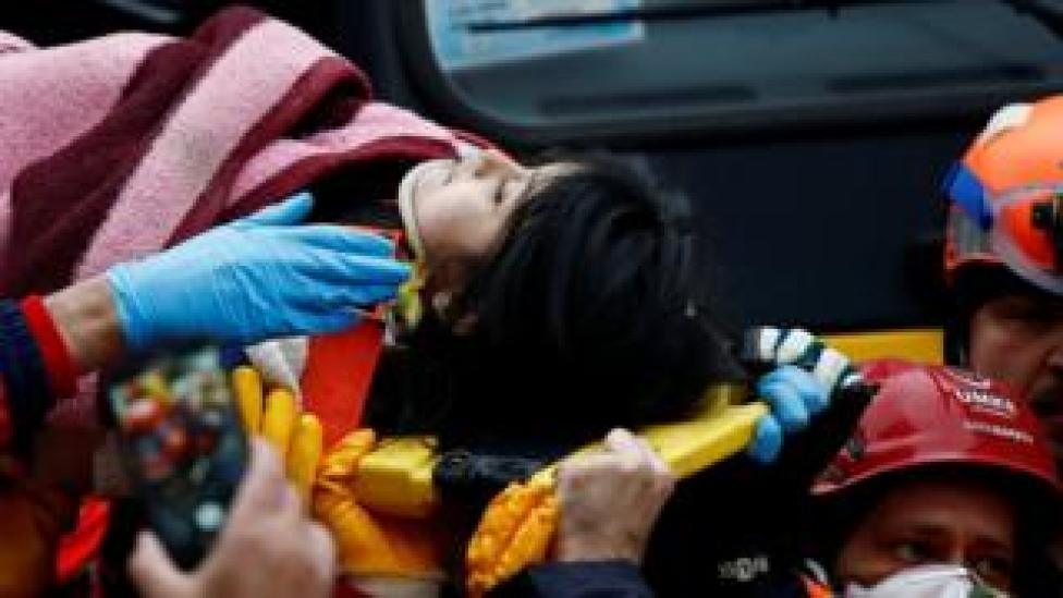 Rescuers carry a young girl on a stretcher at the site of a collapsed residential building in the Kartal district, Istanbul, Turkey, 7 February 2019
