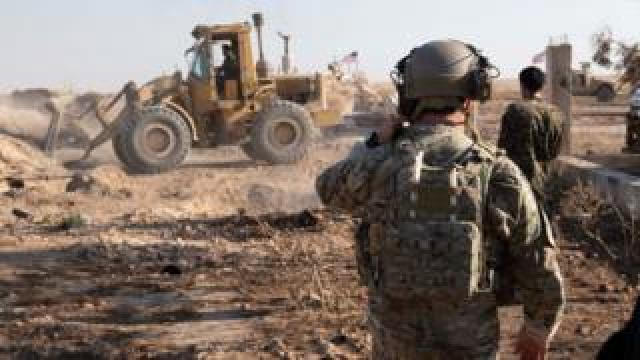 US soldier observes SDF's destruction of military fortification at an unspecified destination in Syria on 22 August 2019