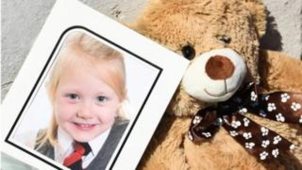 A school picture of Alesha MacPhail is left outside the house on Ardbeg Road on Bute